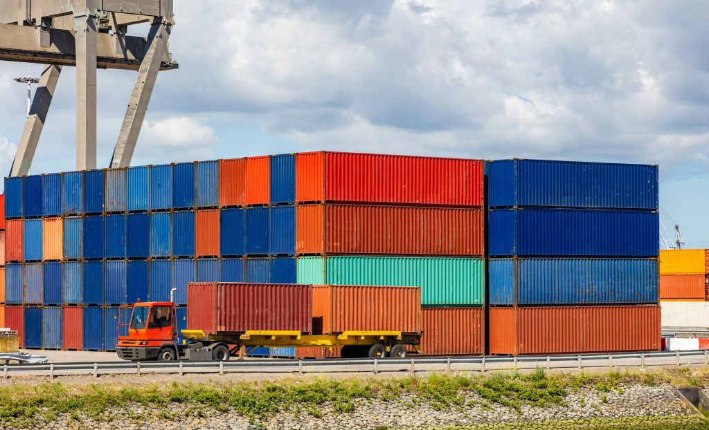 Containers at harbor of Rotterdam, Netherlands. Logistics business, cargo loading unloading