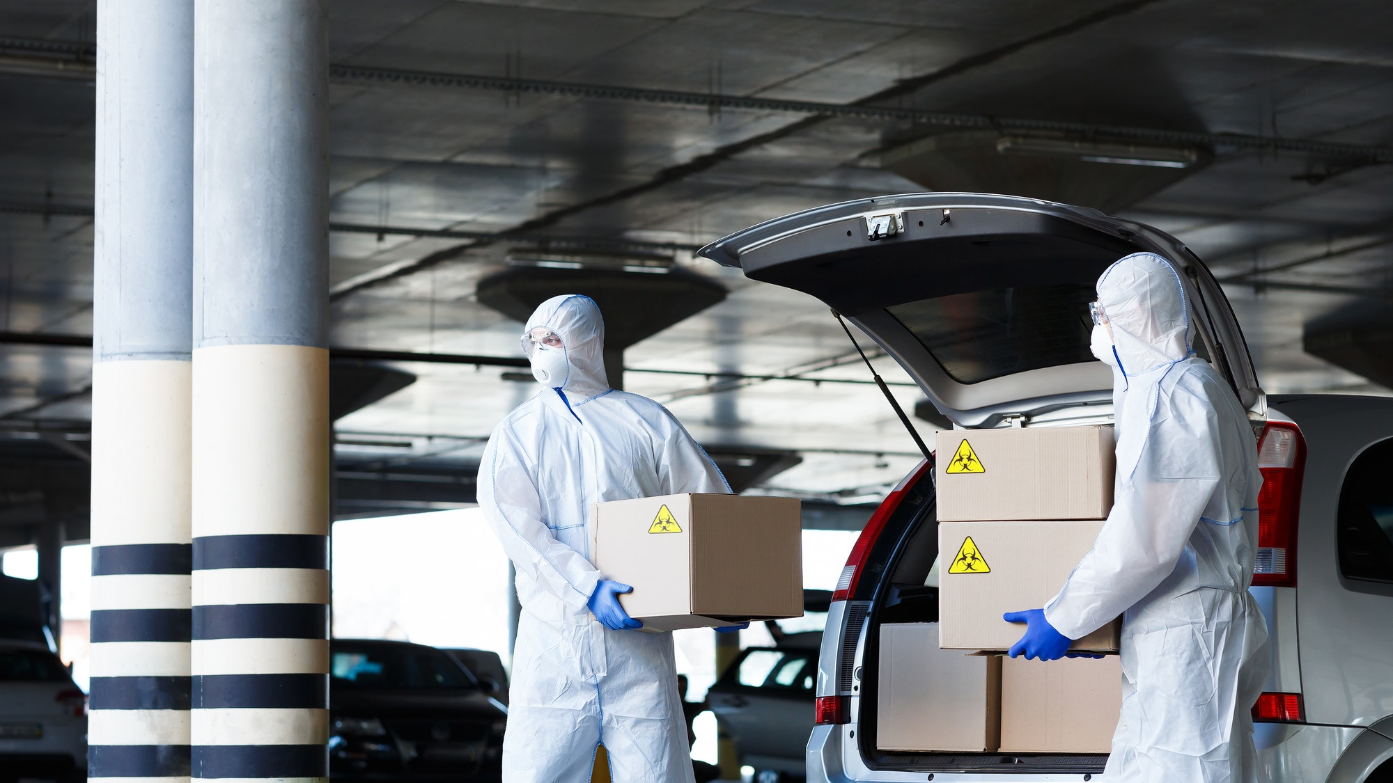 Danger business of trucking, delivering in virus protective suit