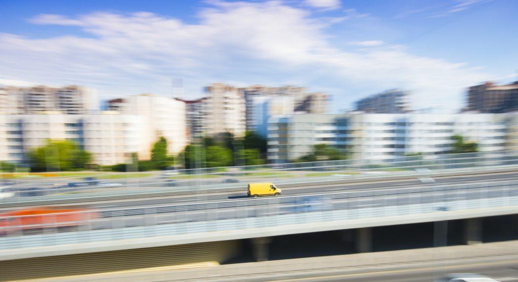 Yellow mini van in city rush